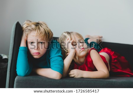 kids- boy and girl -bored staying home