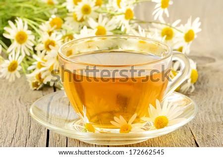 Herbal tea with chamomile flowers. #172662545