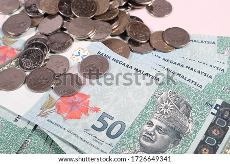 Malaysia Ringgit note and coins isolated on white background. Business and financial concept. Selective focus. Copy space.