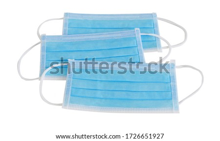 4 layer thick blue face mask is a medical device that protects germs from entering the mouth and nose, placed together in 3 pieces. isolated on white background with clipping path