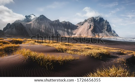 Impressive Colorful Seascape of Iceland. Wonderful picturesque Scene  near Stokksnes cape and Vestrahorn Mountain, Black sand dunes under sunlight on foreground.  #1726656355