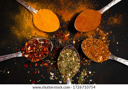 Various spices spoons on stone table. Top view with copy space Royalty-Free Stock Photo #1726710754