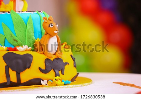 Birthday Cake with cartoon cream design