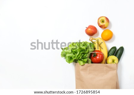 Food delivery. Craft bag with vegetables and fruits on a white background. Online order from the grocery store #1726895854