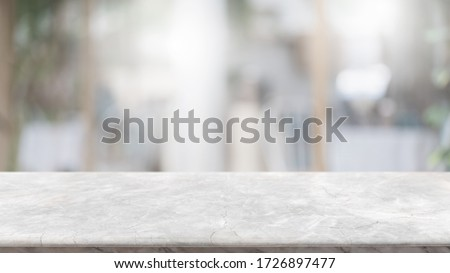 Empty white marble stone table top and blur glass window interior lobby and hall way banner mock up abstract background - can used for display or montage your products. Royalty-Free Stock Photo #1726897477