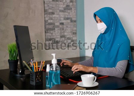 Asian Muslim Women Work in one's own home for social and personal responsibility During the outbreak of the Covid-19 virus, focus on the model, and the concept of quarantine. #1726906267