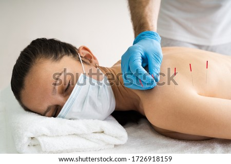 Acupuncture Skin Treatment For Women In Face Mask Royalty-Free Stock Photo #1726918159