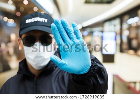 Security Guard Making Stop Hand Gesture In Shopping Mall #1726919035
