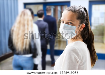 Woman In Face Mask Waiting In Line #1726919086