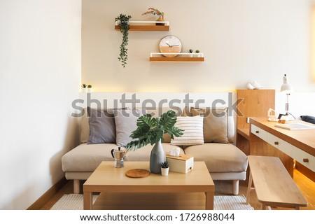 Small Condominium Interior Design Minimal japan design white and wood bedroom and sofa area Royalty-Free Stock Photo #1726988044