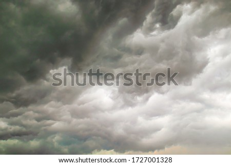 low gray clouds in the sky before the rain, overcast sky with dark clouds Royalty-Free Stock Photo #1727001328