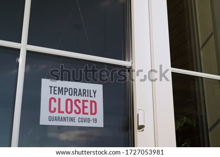 Small business sign on the storefront window closed because of coronavirus or COVID19. #1727053981