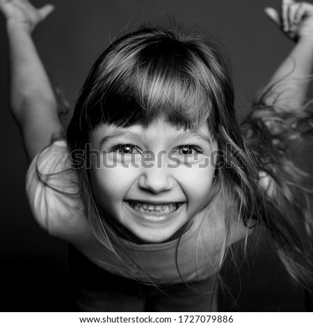 black and white portrait of a beautiful little girl #1727079886