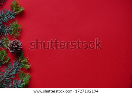 Christmas decorations layout or flatlay with fir branches and cones on red background.Eco natural frame. winter, new year Holidays concept as top view, copyspace. greeting card template