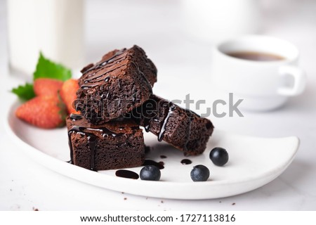 Homemade brownie cake on the white plate looks appetizing. #1727113816