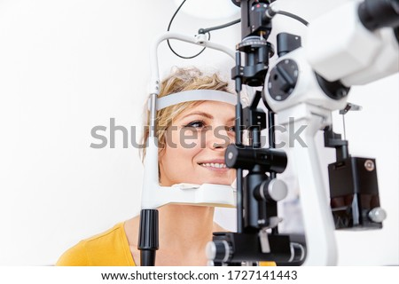 Checking eyesight with Slit lamp, examination of the eyes in an ophthalmology clinic Royalty-Free Stock Photo #1727141443