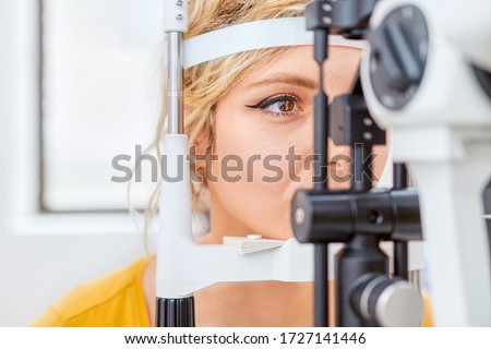 Checking eyesight with Slit lamp, examination of the eyes in an ophthalmology clinic Royalty-Free Stock Photo #1727141446
