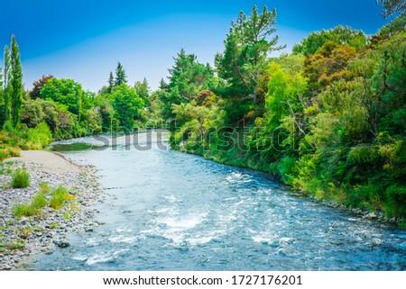 Water turning over rapids on Tongariro River #1727176201