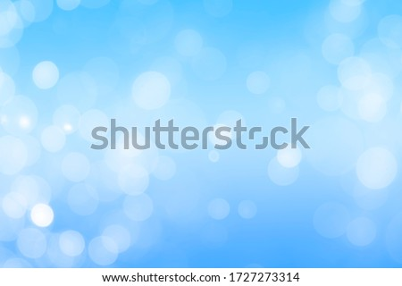 Blue bokeh defocus glitter blur background. Bokeh abstract background.