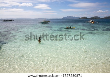 girl on paradise beach under sunny day with sky and blue sea on the beach in pacific islands in the philippines #1727280871