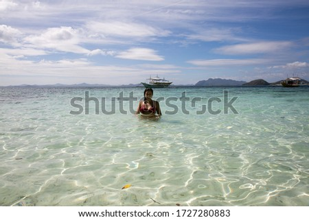 girl on paradise beach under sunny day with sky and blue sea on the beach in pacific islands in the philippines #1727280883