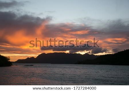 The sun rises over Coron island mountains and sea #1727284000