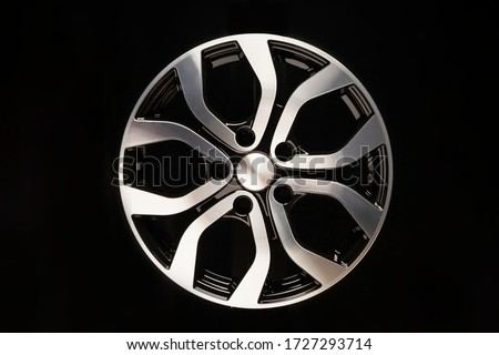 New car alloy wheel, close-up on a black background Royalty-Free Stock Photo #1727293714