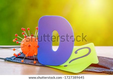Vitamin D help in treating coronavirus. Vitamin D, coronavirus and question mark on a background of sunlight. #1727389645