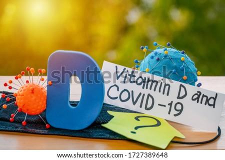 Vitamin D help in treating coronavirus. Vitamin D, coronavirus and question mark on a background of sunlight. #1727389648