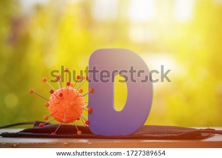 Vitamin D help in treating coronavirus. Vitamin D, coronavirus and question mark on a background of sunlight. #1727389654