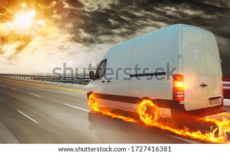 Super fast transportation service with a white van with wheels on fire Royalty-Free Stock Photo #1727416381