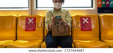 Asian female woman sitting in subway distance for one seat from other people a social distancing for protect coronavirus or covid-19 virus a new normal trend. Social distancing or new normal concepts Royalty-Free Stock Photo #1727464687