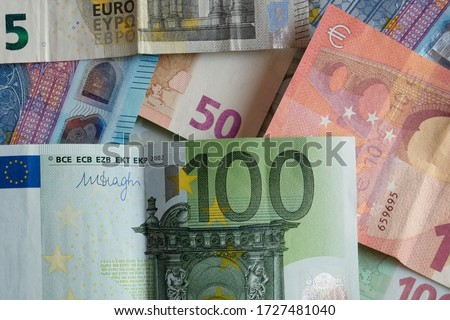 Banknotes of Euro, paper money on flat lay close-up view. Different value  bills together, overlapping each other. Represents the currency of European Union countries. #1727481040