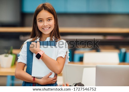 Child care and happy childhood, pretty girl with books ready to first day at school. Royalty-Free Stock Photo #1727546752