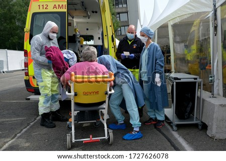 A patient arrives by ambulance for treatment of COVID-19 symptoms at University Hospital of Liege in Belgium on May 5th, 2020. #1727626078
