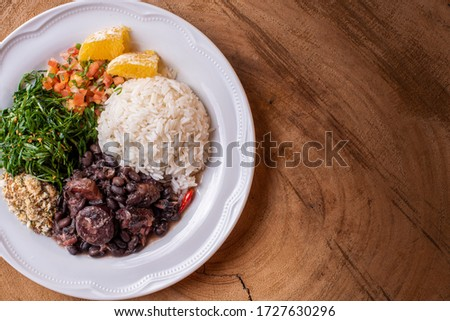 Feijoada, typical Brazilian food with black beans, pork and sausage Royalty-Free Stock Photo #1727630296