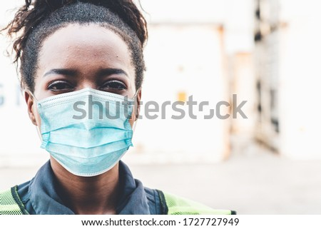 Factory workers with face mask protect from outbreak of Coronavirus Disease 2019 or COVID-19. Concept of protective action and quarantine to stop spreading of Coronavirus Disease 2019 or COVID-19. #1727727949