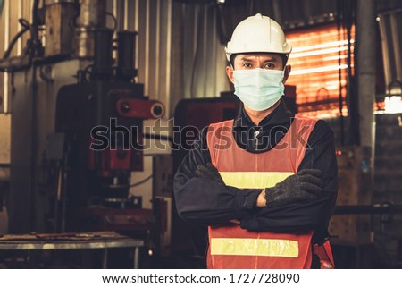 Factory workers with face mask protect from outbreak of Coronavirus Disease 2019 or COVID-19. Concept of protective action and quarantine to stop spreading of Coronavirus Disease 2019 or COVID-19. #1727728090