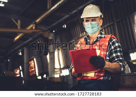 Factory workers with face mask protect from outbreak of Coronavirus Disease 2019 or COVID-19. Concept of protective action and quarantine to stop spreading of Coronavirus Disease 2019 or COVID-19. #1727728183