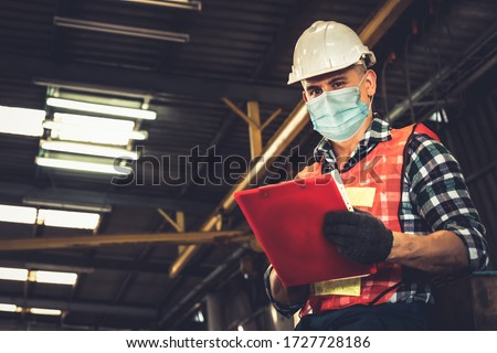 Factory workers with face mask protect from outbreak of Coronavirus Disease 2019 or COVID-19. Concept of protective action and quarantine to stop spreading of Coronavirus Disease 2019 or COVID-19. #1727728186