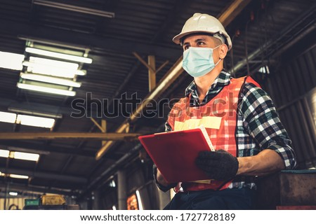 Factory workers with face mask protect from outbreak of Coronavirus Disease 2019 or COVID-19. Concept of protective action and quarantine to stop spreading of Coronavirus Disease 2019 or COVID-19. #1727728189