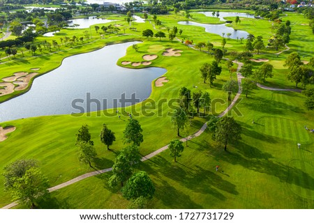 Golf course beautiful Aerial view of golf field landscape with sunrise view in the morning shot. Bangkok Thailand