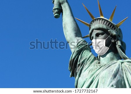 Statue of Liberty in a medical mask. Concept - pandemic in the USA ,. Statue of Liberty on the background of blue sky. Concept - quarantine in New York. Place for an inscription. Epidemic in America. #1727732167