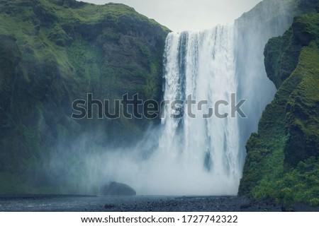Beautiful scenery of the majestic Skogafoss waterfall, Iceland Royalty-Free Stock Photo #1727742322