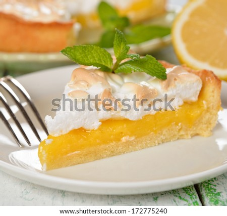 Pie with meringue on a white background closeup