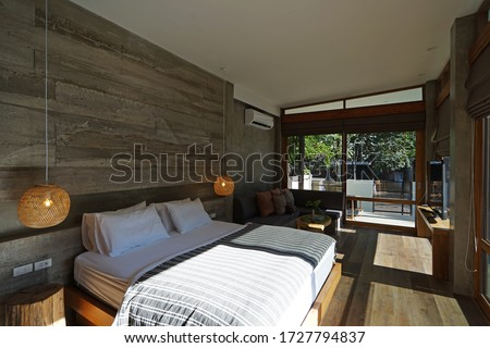 CHIANG MAI,THAILAND-MAY 7,2020:Interior design and decoration of cozy bedroom at 'NANDAKWANG BOUTIQUE POOL VILLA' luxury hide away resort hotel #1727794837