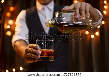 Bartender Serve Whiskey, on wood bar,  #1727821879