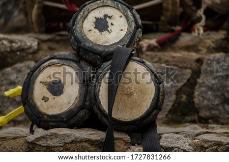 close up of a set of bata drums a popular musical instrument among Yoruba West Africa on a stony background. Pic taken at Abeokuta, Nigeria 2018.