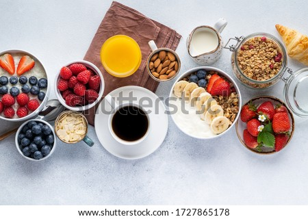 Healthy breakfast set on grey background. The concept of delicious and healthy food. Top view, copy space. #1727865178