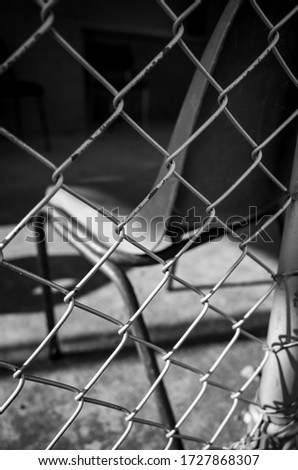 Black and white photo of a wire fence #1727868307